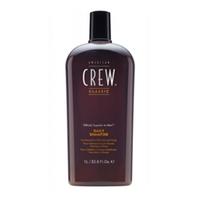 American Crew Classic Daily Shampoo - Шампунь для ежедневного ухода 1000 млСредства для ухода за волосами<br>Предназначенный для ежедневного ухода шампунь American Crew Classic Daily Shampoo включает в себя огромное количество полезных компонентов. Кора мыльного дерева очищает кожу головы и волосы, не влияя при этом на их структуру. Экстракты тимьяна и розмарина придают необходимое увлажнение, а блеск и силу волосам дадут протеины пшеницы. Данное средство рекомендуется для обогащения и очищения жирных и нормальных волос.Способ применения: Во время применения шампуня от компании American Crew его необходимо разбавить водой и нанести на влажные волосы. Массирующими движениями распределить American Crew Classic Daily Shampoo, хорошо вспенивая его по всей длине волос, а затем тщательно смыть. Следите за тем, чтобы средство не попадало в глаза, а в случае попадания – тут же промойте чистой водой.Объем: 1000 мл<br>