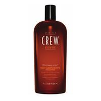 American Crew Classic Daily Moisturizing Shampoo - Шампунь увлажняющий 450 млШампуни мужские<br>Увлажняющий шампунь от компании American Crew – это шампунь, который отлично очищает и увлажняет волосы по всей их длине. Предназначен для сухих и нормальных волос. Входящее в состав рисовое масло придает небывалый блеск и упругость локонам. А благодаря натуральным экстрактам тимьяна и розмарина волосы станут гораздо более влажными и привлекательными. Применение шампуня American Crew Daily Moisturizing Shampoo придаст необходимую мягкость и шелковистость вашим волосам.Способ применения: Применяя шампунь American Crew Daily Moisturizing Shampoo, его необходимо разбавить водой и равномерно массирующими движениями распределить по влажным волосам. Хорошо вспеньте и тщательно промойте голову теплой водой. После применения увлажняющего средства волосы становятся легко расчесываемыми и получают роскошное сияние. При желании повторите процедуру.Объем:450 мл<br>