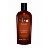 American Crew Classic Body Wash - Гель для душа 450 млМужские средства для душа<br>American Crew Classic Body Wash - это нежный гель для душа с настоящим мужским ароматом, удивительно сочетающим специи и цитрусы. Эксракт корня женьшеня увлажняет и смягчает волосы и кожу головы. Глицерин помогает сохранить естественные свойства кожи. Витамины А и Е улучшают текстуру волос, повышают их силу. Масло кедрового дерева увлажняет сухую кожу головы, избавляет ее от раздражения.Способ применения: Нанести на влажную кожу. Тщательно смыть.Объем: 450 мл<br>