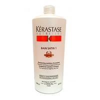 Kerastase Nutritive Irisome Bain Satin 1 Iris Royal - Шампунь-ванна Сатин для нормальных и сухих волос№1 1000млШампуни для волос<br>Шампунь-ванна Сатин №1 подходит для нормальных и сухих волос (преимущественно тонких) с неярко выраженной проблемой ломкости и выпадения. Питательные ингредиенты, включенные в состав шампуня, помогут вернуть вашим волосам здоровье, сияние и мягкость. Шампунь-ванна включает уникальный комплекс Irisome с протеинами и кератином, восстанавливающими структуру волоса.Состав: протеины, кератин, увлажняющие компоненты.Способ применения:Распределите шампунь по волосам. Оставьте на некоторое время. Хорошо промойте волосы.<br>