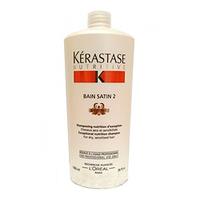 Kerastase Nutritive Irisome Bain Satin 2 Iris Royal-Шампунь-ванна для сухих и чувствительных волос Сатин №2 1000млШампуни для волос<br>Шампунь-ванна Сатин №2 от Керастаз – интенсивное средство для очищения, увлажнения и питания очень сухих волос преимущественно толстых и густых.Шампунь бережно избавляет волосы от грязи и пыли, разглаживает верхний слой, наполняет волосы влагой и силой, придает им естественный блеск. Благодаря уникальной формуле Irisome, созданной на основе экстракта ириса, шампунь укрепляет волосы и препятствует их преждевременному старению.Состав: компонент Irisome, Gluco-Active Complex.Способ применения:Распределите шампунь по волосам. Помассируйте. Тщательно сполосните.<br>